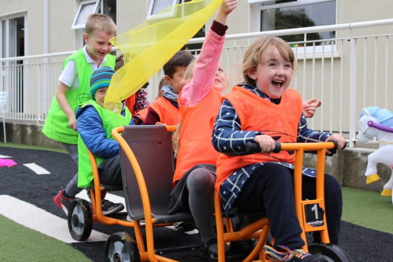 kids riding tricycle in after school club mullingar