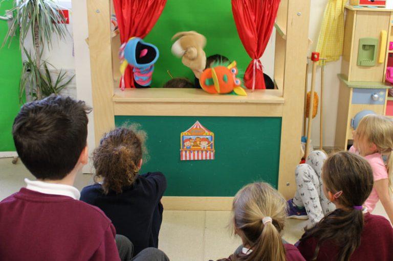 kids watching a puppet show at the den after school care mullingar