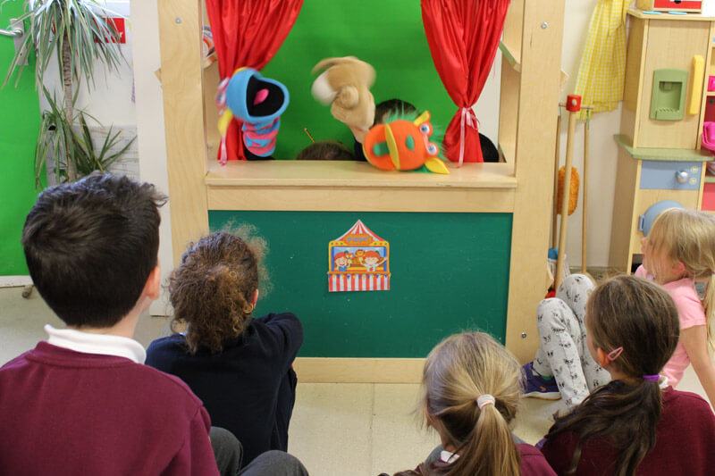 kids watching a puppet show at the den after school care mullingar