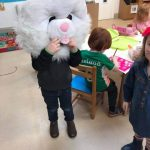 kid wearing giant easter bunny head