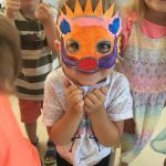 kids wearing masks they made at summer camp