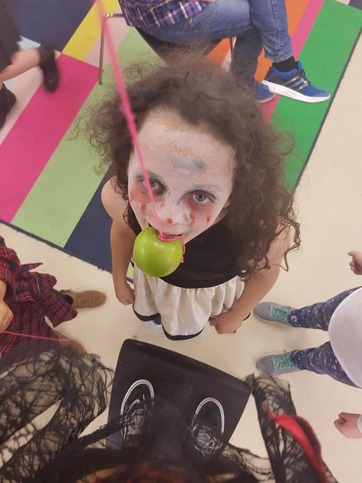 halloween camp mullingar girl eating halloween apple