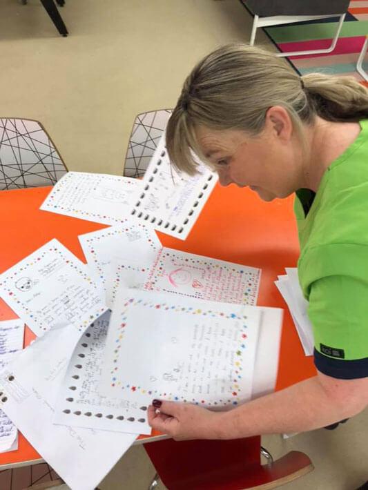 teacher reading pen pal letters