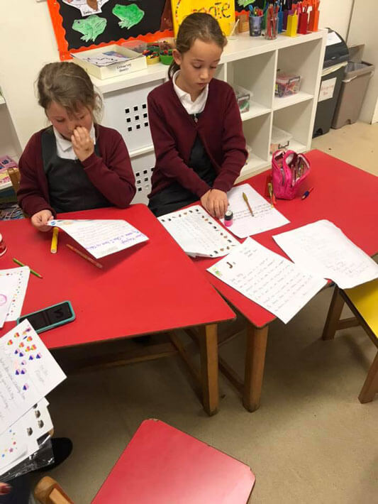 two girls writing pen pal letters