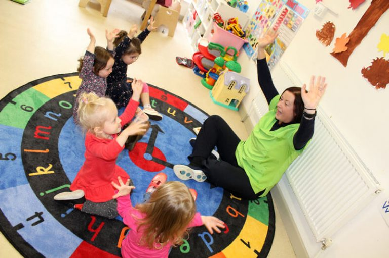 toddler montessori room four kids with teacher doing exercises