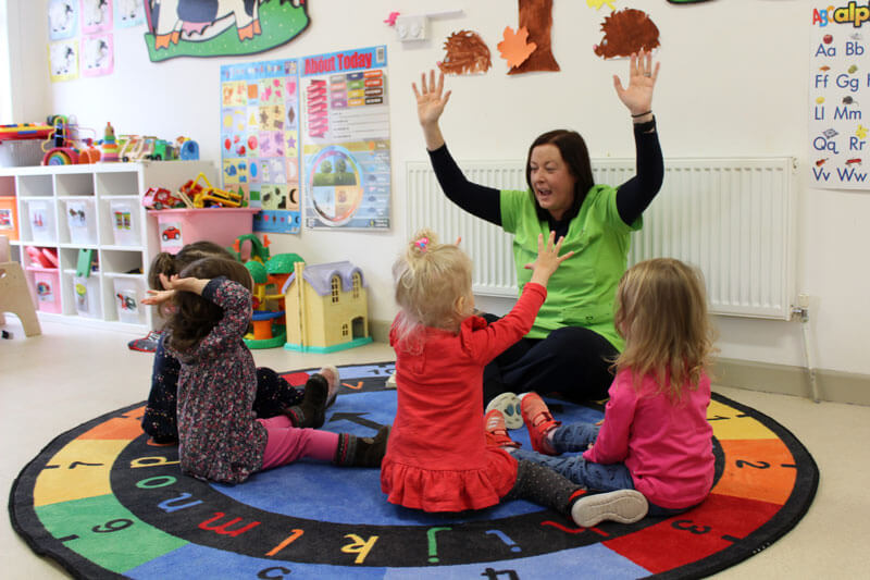 toddler montessori room four kids with teacher