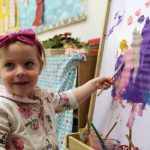 girl painting at montessori mullingar