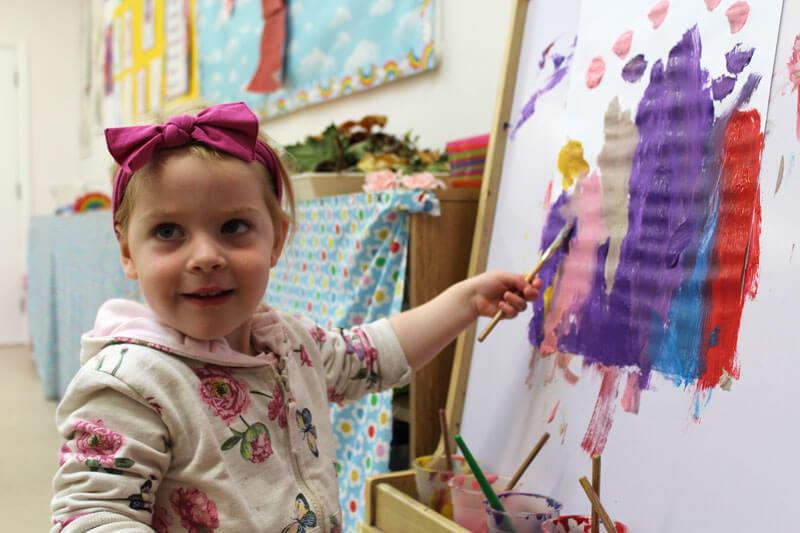 girl painting at montessori mullingar
