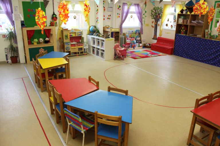 school club homework and relaxation area with toys and books and couch