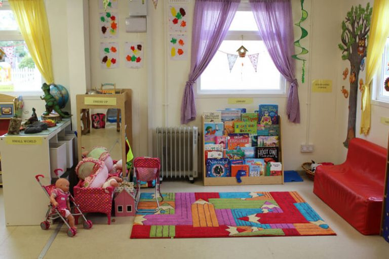 school relaxation area with toys and books and couch