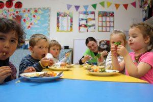 table of children eating their dinner