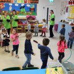 creche kids mullingar marching in a circle playing musical instruments with teachers