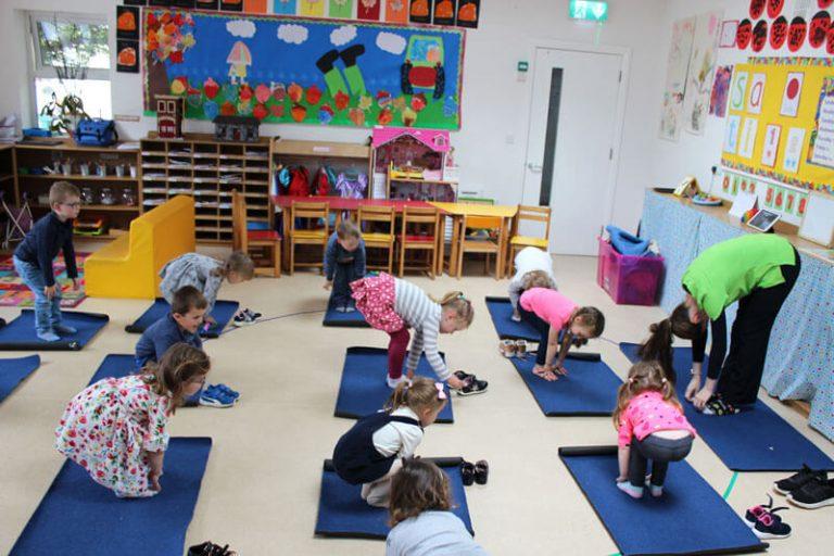 kids doing yoga stretches at mullingar montessori
