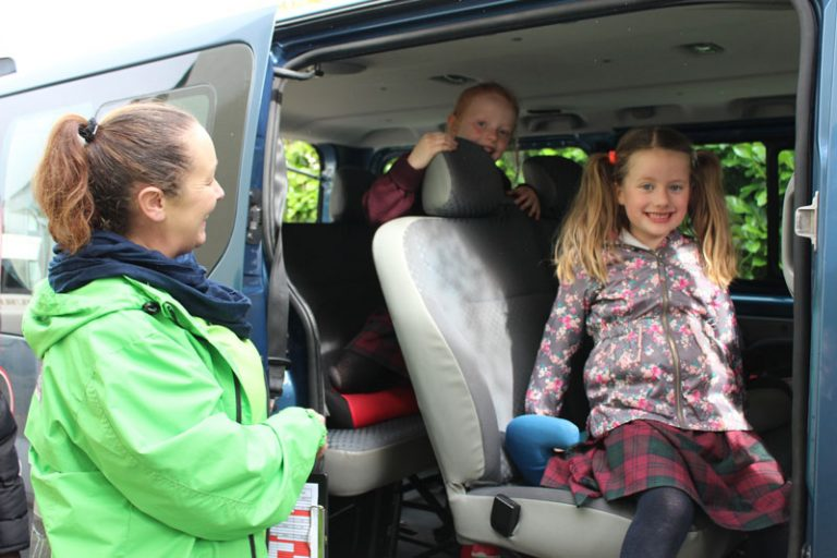 two school girls getting out of minivan at the den mullingar