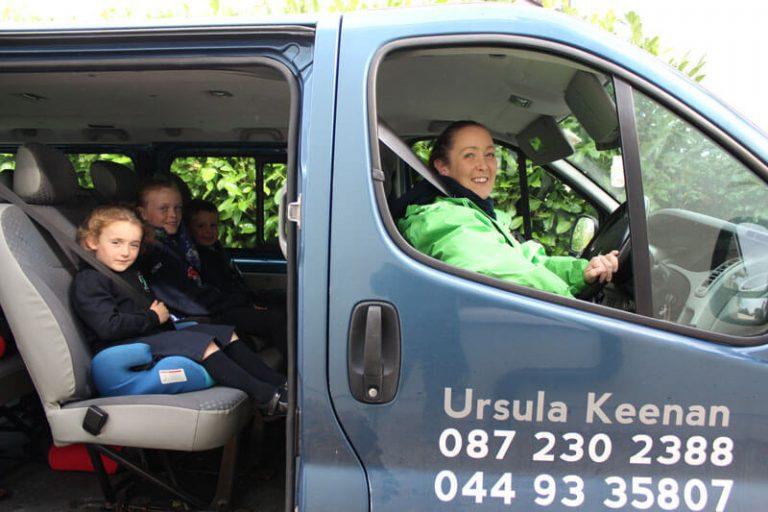 school kids sitting in a minivan