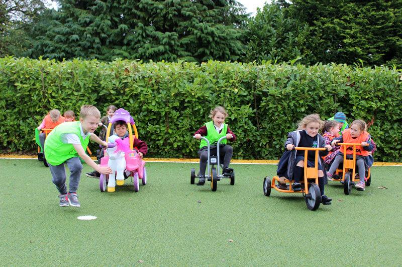 kids playing on pedal bikes