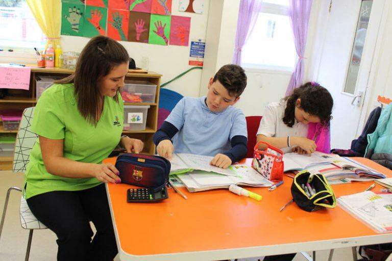two kids and a teacher at Homework Club Mullingar The Den
