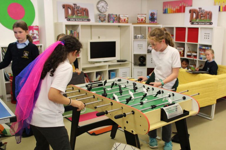 two girls playing table football at the den after school club mullingar town