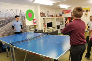 two boys playing table tennis at the den after school club mullingar
