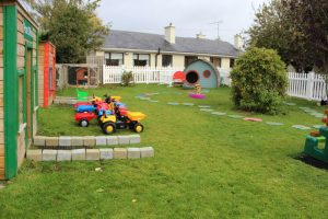 montessori mullingar garden play area with shop and post office and tractors and hobbit house