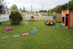 montessori mullingar garden play area with shop and post office and tractors