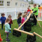 montessori schools mullingar kids playing with water chute