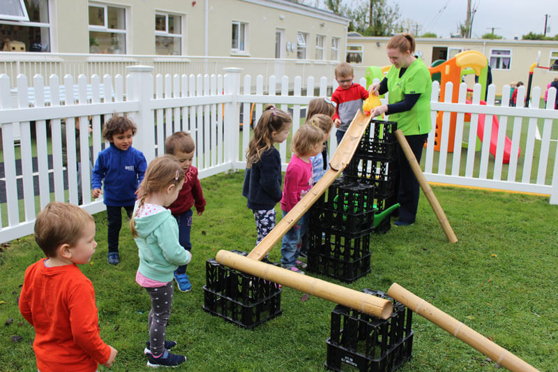 montessori schools mullingar kids playing with water chute