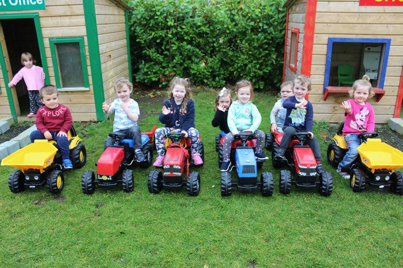 montessori schools mullingar kids playing with tractors