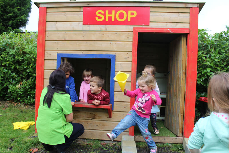 mullingar montessori schools kids playing shop with teacher