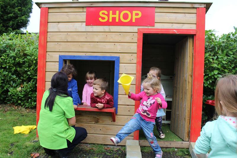 mullingar montessori schools kids playing shop with teacher
