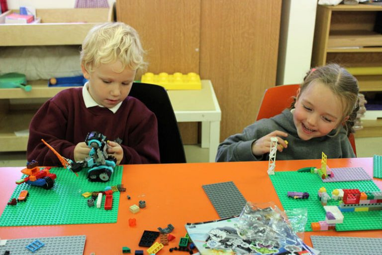 a girl and boy playing with lego in mullingar