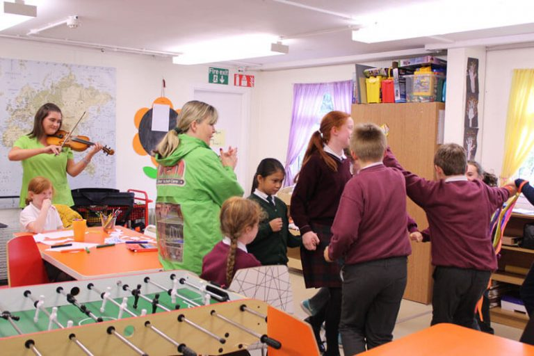 Kids dancing to violin at after school care the den