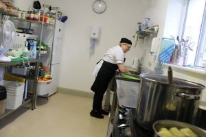 chef in kitchen at mullingar montessori and the den after school care