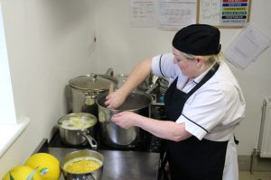 chef in kitchen cooking at mullingar montessori and the den after school care