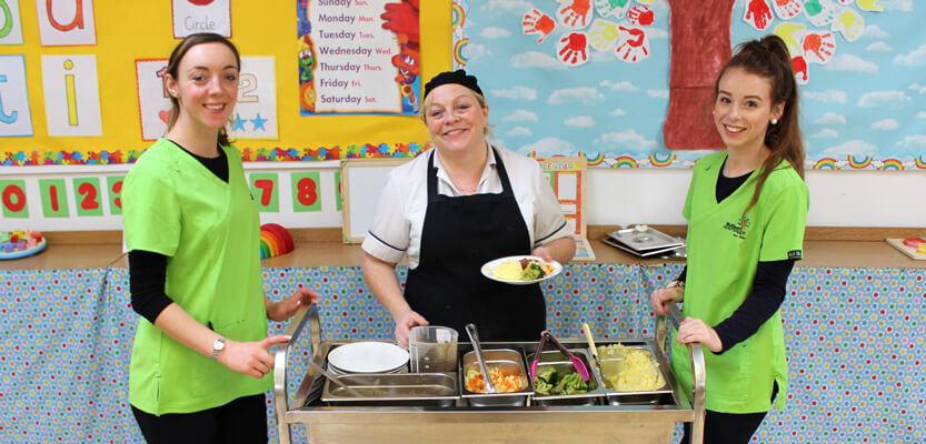 school food service trolley with chef and two servers