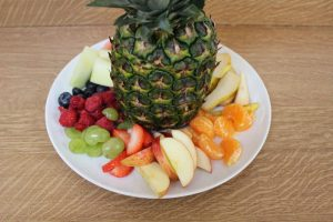 plate with pineapple and assorted fruits